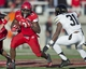 Nov 30, 2013; Salt Lake City, UT, USA; Utah Utes running back Kelvin York (13) runs the ball as Colorado Buffaloes linebacker Paul Vigo (32) pursues the play during the second half at Rice-Eccles Stadium. Utah won 24-17. Mandatory Credit: Russ Isabella-USA TODAY Sports