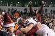 Nov 30, 2013; Charlottesville, VA, USA; Virginia Tech Hokies linebacker Jack Tyler (58) hugs a fan in the stands after the game against the Virginia Cavaliers at Scott Stadium. The Hokies won 16-6. Mandatory Credit: Geoff Burke-USA TODAY Sports