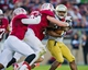 Nov 30, 2013; Stanford, CA, USA; Notre Dame Fighting Irish running back Tarean Folston (25) is tackled by Stanford Cardinal linebacker Kevin Anderson (48) and defensive end Henry Anderson (91) in the first quarter at Stanford Stadium. Mandatory Credit: Matt Cashore-USA TODAY Sports