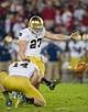 Nov 30, 2013; Stanford, CA, USA; Notre Dame Fighting Irish kicker Kyle Brindza (27) kicks a field goal in the second quarter against the Stanford Cardinal at Stanford Stadium. Mandatory Credit: Matt Cashore-USA TODAY Sports