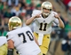 Nov 30, 2013; Stanford, CA, USA; Notre Dame Fighting Irish quarterback Tommy Rees (11) yells to his teammates in the first quarter against the Stanford Cardinal at Stanford Stadium. Mandatory Credit: Matt Cashore-USA TODAY Sports