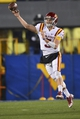 Nov 30, 2013; Morgantown, WV, USA; Iowa State Cyclones quarterback Grant Rohach (3) throws the ball  during the second half  at Milan Puskar Stadium. Iowa State Cyclones defeated West Virginia Mountaineers 52-44 in the third overtime. Mandatory Credit: Tommy Gilligan-USA TODAY Sports