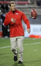 Nov 30, 2013; Las Vegas, NV, USA; UNLV Rebels head coach Bobby Hauck tosses a ball during warmups before an NCAA football game against the San Diego State Aztecs at Sam Boyd Stadium. Mandatory Credit: Stephen R. Sylvanie-USA TODAY Sports