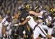 Nov 30, 2013; Columbia, MO, USA; Texas A&M Aggies linebacker Nate Askew (9) sacks Missouri Tigers quarterback James Franklin (1) during the second half at Faurot Field. Missouri defeated Texas A&M 28-21. Mandatory Credit: Peter G. Aiken-USA TODAY Sports