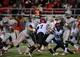 Nov 30, 2013; Las Vegas, NV, USA; UNLV Rebels quarterback Caleb Herring (8) delivers a pass against the San Diego State Aztecs during an NCAA football game at Sam Boyd Stadium. Mandatory Credit: Stephen R. Sylvanie-USA TODAY Sports