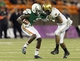 Nov 30, 2013; Honolulu, HI, USA; Army Black Knights defensive back Steven Johnson (14) tries to pull down Hawaii Warriors wide receiver Chris Gant (9) during the third quarter at Aloha Stadium. Mandatory Credit: Marco Garcia-USA TODAY Sports