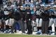 Dec 1, 2013; Charlotte, NC, USA; Carolina Panthers head coach Ron Rivera (center) reacts in the fourth quarter. The  Panthers defeated the Tampa Bay Buccaneers 27-6 at Bank of America Stadium. Mandatory Credit: Bob Donnan-USA TODAY Sports