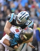 Dec 1, 2013; Charlotte, NC, USA; Tampa Bay Buccaneers quarterback Mike Glennon (8) is sacked by Carolina Panthers inside linebacker A.J. Klein (56) in the third quarter. The Carolina Panthers defeated the Tampa Bay Buccaneers 27-6 at Bank of America Stadium. Mandatory Credit: Bob Donnan-USA TODAY Sports