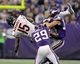 Dec 1, 2013; Minneapolis, MN, USA; Chicago Bears wide receiver Brandon Marshall (15) is tackled by Minnesota Vikings cornerback Xavier Rhodes (29) and safety Andrew Sendejo (34) during overtime at Mall of America Field at H.H.H. Metrodome. The Vikings defeated the Bears 23-20 in overtime. Mandatory Credit: Brace Hemmelgarn-USA TODAY Sports