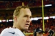 Dec 1, 2013; Kansas City, MO, USA; Denver Broncos quarterback Peyton Manning (18) walks off the field after the game against the Kansas City Chiefs at Arrowhead Stadium. Denver won 35-28. Mandatory Credit: Denny Medley-USA TODAY Sports