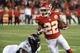 Dec 1, 2013; Kansas City, MO, USA; Kansas City Chiefs wide receiver Dexter McCluster (22) gets past Denver Broncos defensive tackle Terrance Knighton (94) in the second half at Arrowhead Stadium. Denver won the game 35-28. Mandatory Credit: John Rieger-USA TODAY Sports