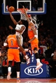 Dec 1, 2013; New York, NY, USA;  New Orleans Pelicans point guard Tyreke Evans (1) shoots over New York Knicks power forward Kenyon Martin (3) during the second quarter at Madison Square Garden. Mandatory Credit: Anthony Gruppuso-USA TODAY Sports