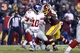 Dec 1, 2013; Landover, MD, USA;  New York Giants quarterback Eli Manning (10) is sacked by Washington Redskins outside linebacker Brian Orakpo (98) in the third quarter at FedEx Field. The Giants won 24-17. Mandatory Credit: Geoff Burke-USA TODAY Sports