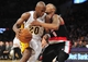 December 1, 2013; Los Angeles, CA, USA; Los Angeles Lakers shooting guard Jodie Meeks (20) moves the ball against the defense of Portland Trail Blazers point guard Damian Lillard (0) during the second half at Staples Center. Mandatory Credit: Gary A. Vasquez-USA TODAY Sports