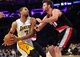 December 1, 2013; Los Angeles, CA, USA; Los Angeles Lakers small forward Xavier Henry (7) moves the ball against the defense of Portland Trail Blazers center Joel Freeland (19) during the second half at Staples Center. Mandatory Credit: Gary A. Vasquez-USA TODAY Sports