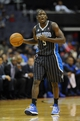 Dec 2, 2013; Washington, DC, USA; Orlando Magic shooting guard Victor Oladipo (5) dribbles the ball against the Washington Wizards during the second half at the Verizon Center. The Wizards defeated the Magic 98 - 80. Mandatory Credit: Brad Mills-USA TODAY Sports