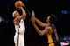 Nov 27, 2013; Brooklyn, NY, USA; Brooklyn Nets small forward Paul Pierce (34) puts up a shot over Los Angeles Lakers small forward Nick Young (0) at Barclays Center. The Lakers won 99-94. Mandatory Credit: Joe Camporeale-USA TODAY Sports