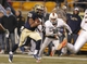 Nov 29, 2013; Pittsburgh, PA, USA; Pittsburgh Panthers running back Rachid Ibrahim (29) rushes the football against the Miami Hurricanes during the fourth quarter at Heinz Field. Miami won 41-31. Mandatory Credit: Charles LeClaire-USA TODAY Sports