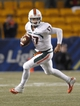 Nov 29, 2013; Pittsburgh, PA, USA; Miami Hurricanes quarterback Stephen Morris (17) scrambles with the ball against the Pittsburgh Panthers during the third quarter at Heinz Field. Miami won 41-31. Mandatory Credit: Charles LeClaire-USA TODAY Sports