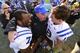 Nov 30, 2013; Chapel Hill, NC, USA;  Duke Blue Devils quarterbacks Anthony Boone (7) and Brandon Connette (18) with quarterbacks coach Kurt Roper after the game. The Blue Devils defeated the North Carolina Tar Heels 27-25 at Kenan Memorial Stadium. Mandatory Credit: Bob Donnan-USA TODAY Sports