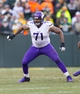 Nov 24, 2013; Green Bay, WI, USA; Minnesota Vikings offensive tackle Phil Loadholt (71) during the game against the Green Bay Packers at Lambeau Field.  The Vikings and Packers tied 26-26.  Mandatory Credit: Jeff Hanisch-USA TODAY Sports