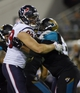 Dec 5, 2013; Jacksonville, FL, USA; Houston Texans defensive end J.J. Watt (99) tries to get past Jacksonville Jaguars center Brad Meester (63) in the third quarter at EverBank Field. Mandatory Credit: Phil Sears-USA TODAY Sports
