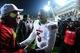 Dec 5, 2013; Cincinnati, OH, USA; Louisville Cardinals quarterback Teddy Bridgewater (5) celebrates with fans after defeating the Cincinnati Bearcats 31-24 at Nippert Stadium. Mandatory Credit: Andrew Weber-USA TODAY Sports