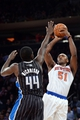 Dec 6, 2013; New York, NY, USA; New York Knicks small forward Metta World Peace (51) puts up a shot over Orlando Magic power forward Andrew Nicholson (44) during the second half at Madison Square Garden. The Knicks won the game 121-83. Mandatory Credit: Joe Camporeale-USA TODAY Sports