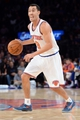 Dec 6, 2013; New York, NY, USA; New York Knicks point guard Pablo Prigioni (9) dribbles against the Orlando Magic during the second half at Madison Square Garden. The Knicks won the game 121-83. Mandatory Credit: Joe Camporeale-USA TODAY Sports