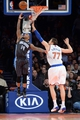 Dec 6, 2013; New York, NY, USA; Orlando Magic point guard Jameer Nelson (14) puts up a shot over New York Knicks power forward Andrea Bargnani (77) during the second half at Madison Square Garden. The Knicks won the game 121-83. Mandatory Credit: Joe Camporeale-USA TODAY Sports