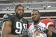 Dec 1, 2013; Philadelphia, PA, USA;  Philadelphia Eagles defensive end Clifton Geathers (90) and Arizona Cardinals defensive end Frostee Rucker (98) after the game at Lincoln Financial Field. The Philadelphia Eagles won the game 24-21.  Mandatory Credit: John Geliebter-USA TODAY Sports