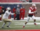 Dec 7, 2013; Dallas, TX, USA; Southern Methodist Mustangs quarterback Neal Burcham (12) scrambles away from UCF Knights defensive lineman Miles Pace (44) during the first half of an NCAA football game at Gerald J. Ford Stadium. Mandatory Credit: Jim Cowsert-USA TODAY Sports