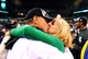 Dec 7, 2013; Indianapolis, IN, USA; Michigan State Spartans head coach Mark Dantonio kisses his wife Becky Dantonio after defeating Ohio State Buckeyes 34-24 to win the 2013 Big 10 Championship game  at Lucas Oil Stadium. Mandatory Credit: Andrew Weber-USA TODAY Sports