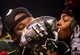 Dec 7, 2013; Indianapolis, IN, USA; Michigan State Spartans players kiss the championship trophy after defeating Ohio State Buckeyes 34-24 to win the 2013 Big 10 Championship game at Lucas Oil Stadium. Mandatory Credit: Andrew Weber-USA TODAY Sports