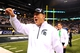 Dec 7, 2013; Indianapolis, IN, USA; Michigan State Spartans head coach Mark Dantonio celebrates after defeating Ohio State Buckeyes 34-24 to win the 2013 Big 10 Championship game at Lucas Oil Stadium. Mandatory Credit: Andrew Weber-USA TODAY Sports