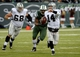 Dec 8, 2013; East Rutherford, NJ, USA; Oakland Raiders quarterback Matt McGloin (14) is chased by New York Jets outside linebacker Quinton Coples (98) during the game at MetLife Stadium. Mandatory Credit: Robert Deutsch-USA TODAY Sports