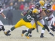 Dec 8, 2013; Green Bay, WI, USA; Green Bay Packers running back Eddie Lacy (27) is tackled by Atlanta Falcons defensive end Osi Umenyiora (50) during the fourth quarter at Lambeau Field.  Green Bay won 22-21.  Mandatory Credit: Jeff Hanisch-USA TODAY Sports