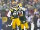 Dec 8, 2013; Green Bay, WI, USA; Green Bay Packers cornerback Jarrett Bush (24) celebrates an interception during the fourth quarter against the Atlanta Falcons at Lambeau Field.  Green Bay won 22-21.  Mandatory Credit: Jeff Hanisch-USA TODAY Sports