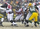Dec 8, 2013; Green Bay, WI, USA; Atlanta Falcons running back Jacquizz Rodgers (32) rushes with the football during the fourth quarter against the Green Bay Packers at Lambeau Field.  Green Bay won 22-21.  Mandatory Credit: Jeff Hanisch-USA TODAY Sports
