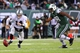 Dec 8, 2013; East Rutherford, NJ, USA; Oakland Raiders quarterback Matt McGloin (14) chases after a fumble with New York Jets outside linebacker Quinton Coples (98) during the second half at MetLife Stadium. The Jets defeated the Raiders 37-27.  Mandatory Credit: Ed Mulholland-USA TODAY Sports
