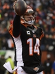 Dec 8, 2013; Cincinnati, OH, USA; Cincinnati Bengals quarterback Andy Dalton (14) smiles while holding up the ball after running into the end zone for a touch down during the second half of the game at Paul Brown Stadium. Cincinnati Bengals beat Indianapolis Colts 42-28 Mandatory Credit: Marc Lebryk-USA TODAY Sports