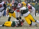 Dec 8, 2013; Green Bay, WI, USA;  Atlanta Falcons running back Steven Jackson (39) is tackled by Green Bay Packers defensive tackle Ryan Pickett (79) and cornerback Tramon Williams (38) in the 4th quarter at Lambeau Field. Mandatory Credit: Benny Sieu-USA TODAY Sports