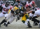 Dec 8, 2013; Green Bay, WI, USA;  Green Bay Packers running back James Starks (44) is tackled by Atlanta Falcons defensive tackle Peria Jerry (94) and defensive end Osi Umenyiora (50) in the 4th quarter at Lambeau Field. Mandatory Credit: Benny Sieu-USA TODAY Sports