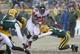 Dec 8, 2013; Green Bay, WI, USA;  Atlanta Falcons running back Steven Jackson (39) tries to run between Green Bay Packers linebacker Jamari Lattimore (57) and cornerback Micah Hyde (33) in the 4th quarter at Lambeau Field. Mandatory Credit: Benny Sieu-USA TODAY Sports