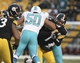 Dec 8, 2013; Pittsburgh, PA, USA; Pittsburgh Steelers quarterback Ben Roethlisberger (7) is hit after throwing a pass by Miami Dolphins defensive end Olivier Vernon (50) during the second half at Heinz Field. The Dolphins won the game, 34-28. Mandatory Credit: Jason Bridge-USA TODAY Sports