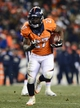 Dec 8, 2013; Denver, CO, USA; Denver Broncos running back Knowshon Moreno (27) rushes in the fourth quarter against the Tennessee Titans at Sports Authority Field at Mile High. The Broncos defeated the Titans 51-28. Mandatory Credit: Ron Chenoy-USA TODAY Sports