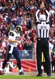Dec 8, 2013; Phoenix, AZ, USA; St. Louis Rams quarterback Kellen Clemens (10) reacts after being sacked for a safety in the third quarter against the Arizona Cardinals at University of Phoenix Stadium. The Cardinals defeated the Rams 30-10. Mandatory Credit: Mark J. Rebilas-USA TODAY Sports