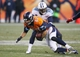 Dec 8, 2013; Denver, CO, USA; Denver Broncos wide receiver Eric Decker (87) is tackled by Tennessee Titans cornerback Alterraun Verner (20) during the second half at Sports Authority Field at Mile High. The Broncos won 51-28.  Mandatory Credit: Chris Humphreys-USA TODAY Sports