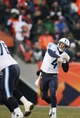 Dec 8, 2013; Denver, CO, USA; Tennessee Titans quarterback Ryan Fitzpatrick (4) throws the ball during the second half against the Denver Broncos at Sports Authority Field at Mile High. The Broncos won 51-28.  Mandatory Credit: Chris Humphreys-USA TODAY Sports