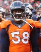 Dec 8, 2013; Denver, CO, USA; Denver Broncos linebacker Von Miller (58) on the sidelines during the second half against the Tennessee Titans at Sports Authority Field at Mile High. The Broncos won 51-28.  Mandatory Credit: Chris Humphreys-USA TODAY Sports